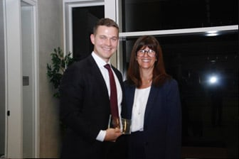 Second place winner Michael Hopkins from Sheppard Mullin Richter & Hampton LLP with The Honorable Judge Cathy Ann Bencivengo of the US District Court for the Southern District of California